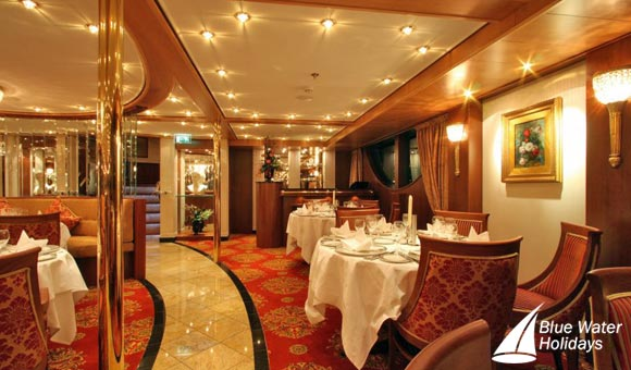 Enjoy superb cuisine in the elegant dining room on Swiss Sapphire
