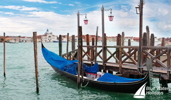 Enjoy a romantic gondola ride in Venice