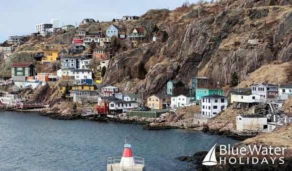 Colourful houses clinging to the rocky cliffs