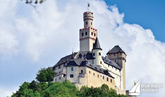 Admire fairytale castles along the Rhine