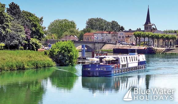 Cruise through France on a 22-passenger hotel barge