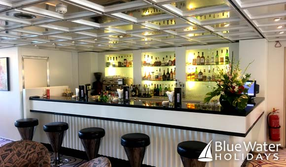 Enjoy a drink at the bar in the Charleston Lounge