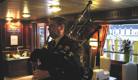 Bagpiper on board Lord of the Glens